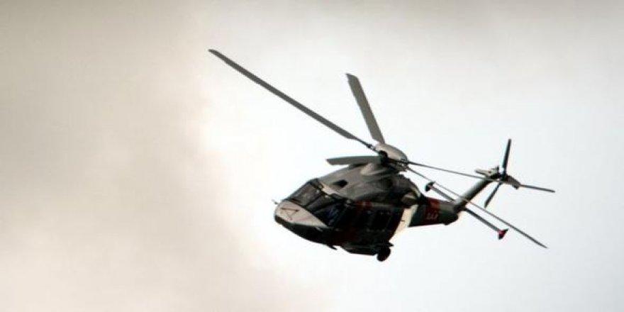 Pilot helikopterden düştü