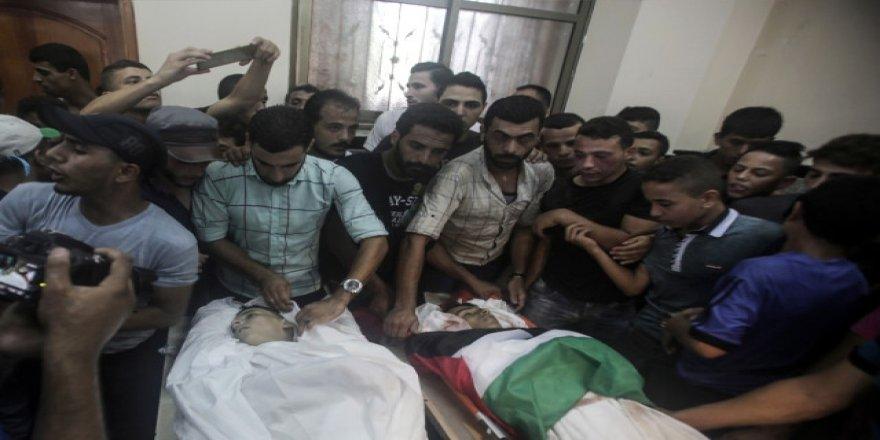 İsrail saldırısında şehit olan 2 çocuğun cenaze törenine binlerce kişi katıldı