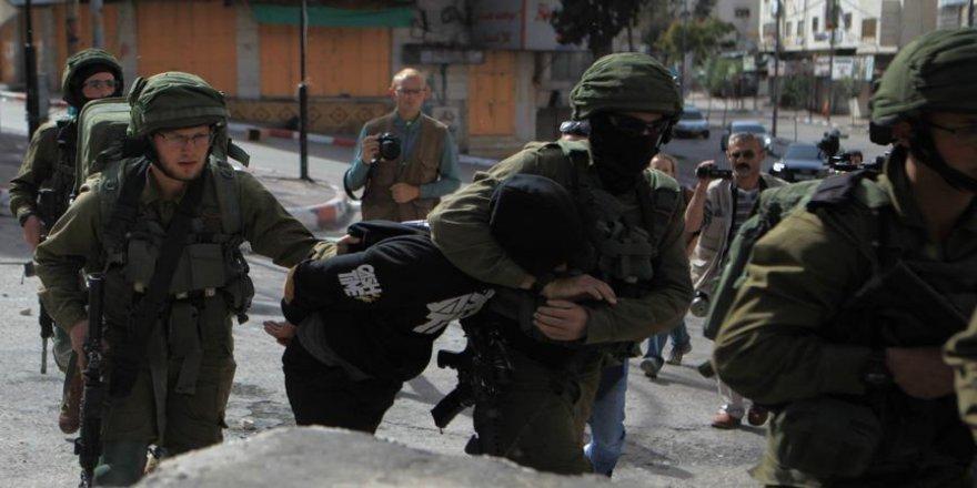 İsrail güçleri 28 Filistinliyi gözaltına aldı