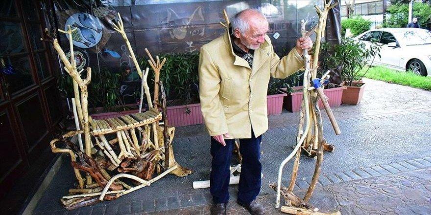 Parkinson hastası Ayhan, ağaçlardan süs eşyası yaparak hayata tutunuyor