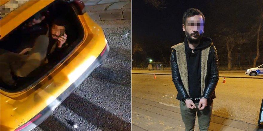 Ceza yememek için taksinin bagajında yolculuk yaparken yakalandı