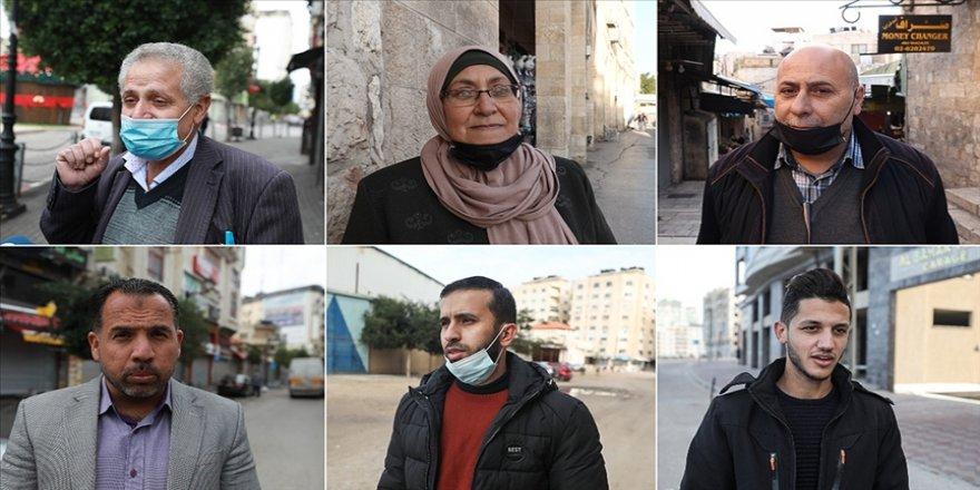 Filistinliler seçim kararından memnun olsa da siyasi bölünmüşlüğe çözüm getirmeyeceğini düşünüyor