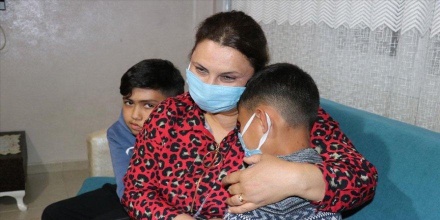 Adana'da iki çocuklu çift, doğuştan engelli Berkcan'ın koruyucu ailesi oldu