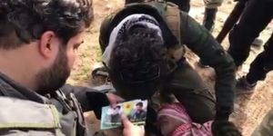Afrin'de  YPG'liyi silahıyla yakaladılar