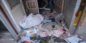 Bir evde 2 römork dolusu çöp çıktı