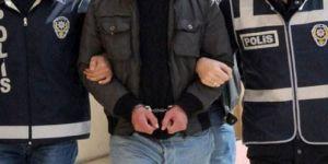 Silah satarak PKK'ya finans sağlayan 2 kişi gözaltına alındı