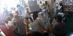 Eczane basan Suriyeliler çalışanın kulağını kesti