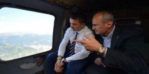 İki bakan Yusufeli Barajı'nı havadan inceledi