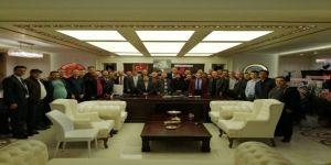 EYT'lilerden Bakkalcıoğlu'na 'hayırlı olsun' ziyareti