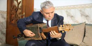 Iraklı öğretmen kalaşnikof tüfeğini müzik aletine dönüştürdü