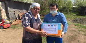 Kazakistan'da TİKA ve Türk büyükelçiliğinden ihtiyaç sahiplerine gıda yardımı