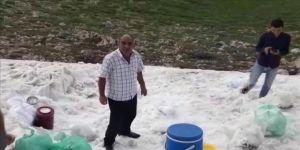 Sıcaktan bunalanlar iftarı Nemrut Dağı'ndaki kar ile yapıyor
