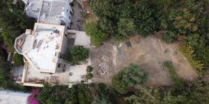 Firari gazeteci Can Dündar'ın villasının havuzu yıkılarak molozla dolduruldu