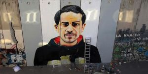 Filistinli ressam Utanç Duvarı'na Floyd'dan sonra şehit İyad Hallak'ı da resmetti