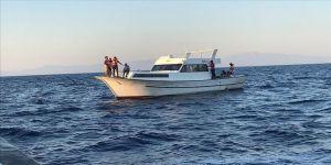 Muğla'da Türk kara sularına itilen 83 sığınmacı kurtarıldı