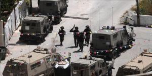 İsrail güçleri, Batı Şeria ile Doğu Kudüs'te 21 Filistinliyi gözaltına aldı